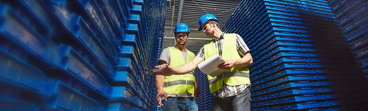 A banner image features a close-up photograph of two caucasian CHEP workmen in fluorescent vests and hard hats in a warehouse full of pallets. The men are observing a clipboard and paper beside a stack of blue chep pallets.