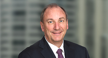 A portrait photograph of Brambles' Non-Executive Chairman, John Mullen