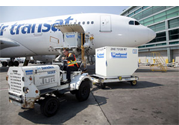 A photograph of an aeroplane being loading with freight